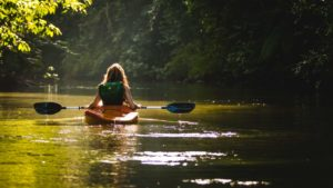 Woman kayaking in a calm river