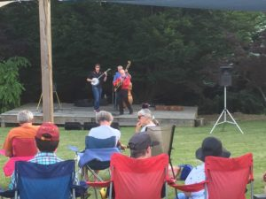 One of the groups performing at Music in the Garden - this is a 3-person group playing a guitar, banjo, and string bass.