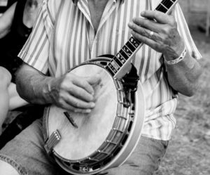 Older man playing a banjo