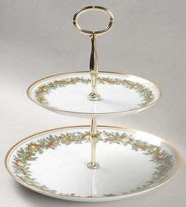two-tiered serving plate with a Christmas greenery pattern
